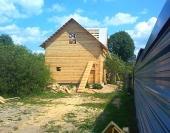 Вид на брусовой дом издали